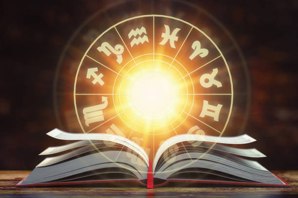 Astrology horoscope concept. Opened  book with magic zodiac signs and symbols. stock photo