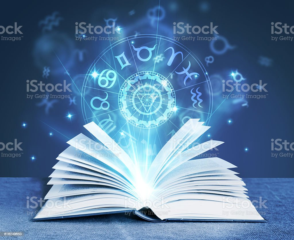 astrology magic book stock photo