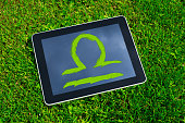 Astrology Sign Libra on the grass on digital tablet