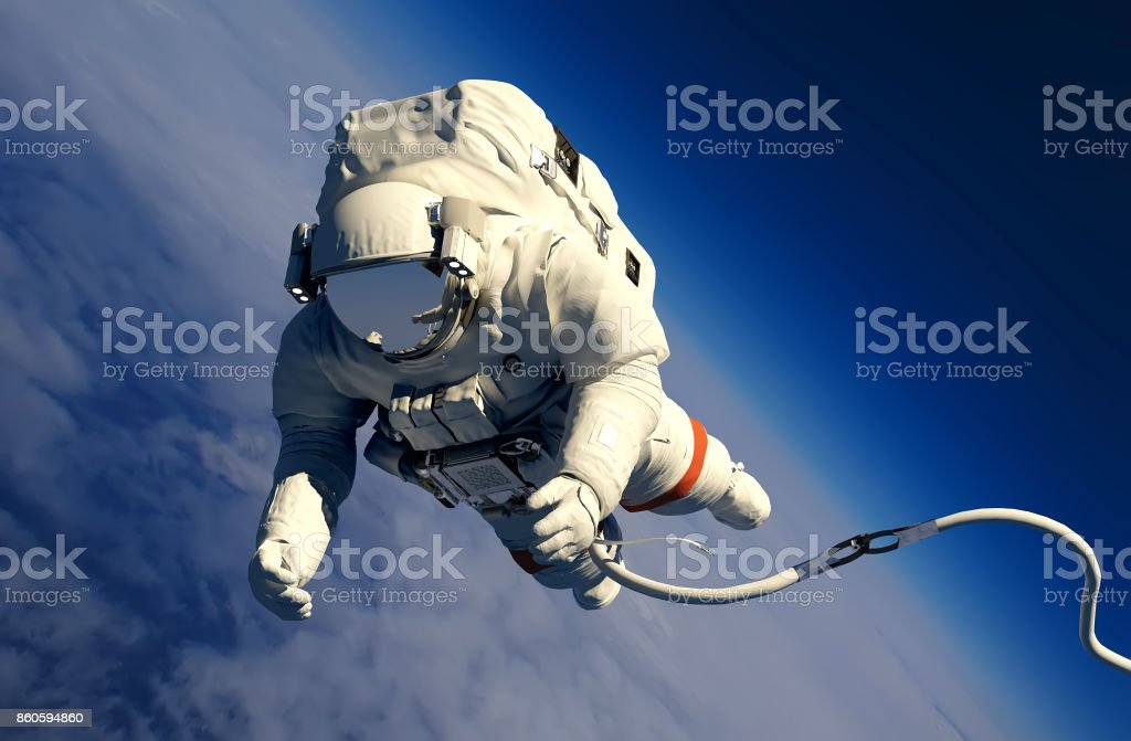 Astronaut above the clouds stock photo