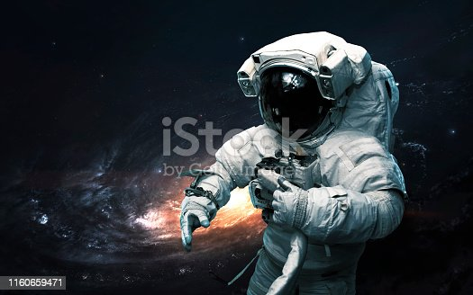istock Astronaut against galaxy. Science fiction art. Elements of this image furnished by NASA 1160659471