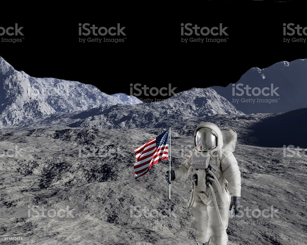 Astronaut against lunar background stock photo