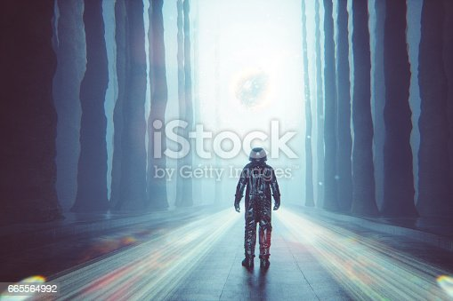 istock Astronaut against mysterious glowing orb 665564992