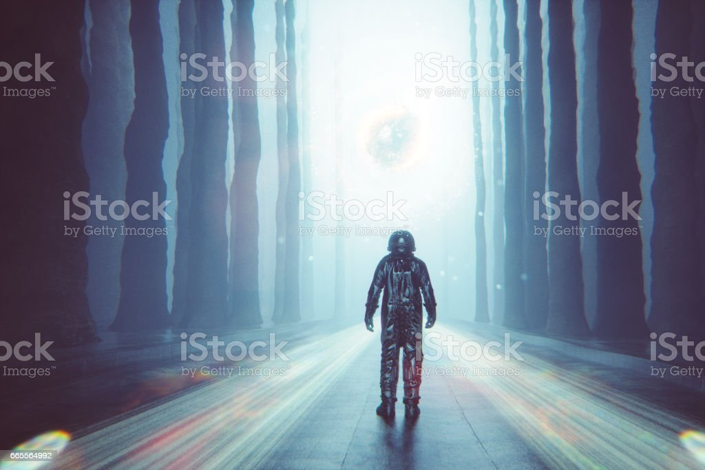 Astronaut against mysterious glowing orb stock photo