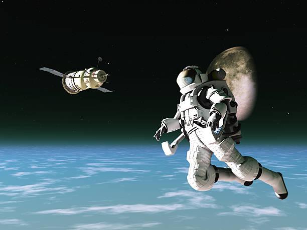 Astronaut and satellite stock photo