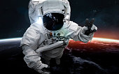 Astronaut at spacewalk. Science fiction art. Elements of this image furnished by NASA