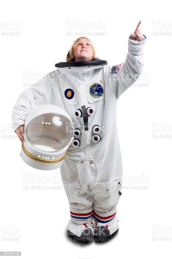 Astronaut boy in spacesuit pointing towards the sky stock photo