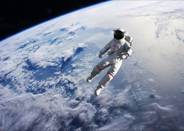 Astronaut conducting spacewalk on Earth orbit. stock photo
