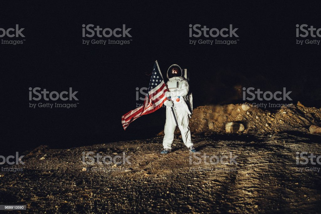 US astronaut conquering Mars stock photo