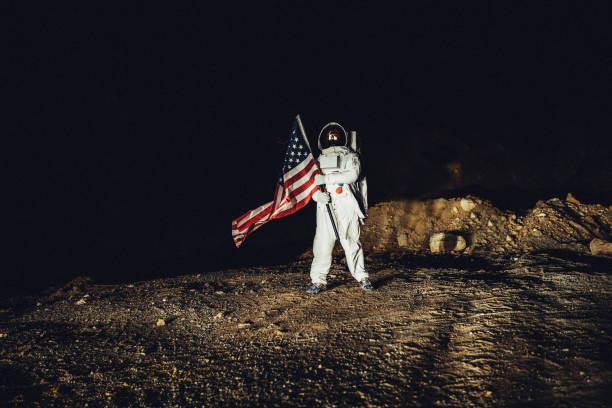 us astronaut conquering mars - moon stock photos and pictures