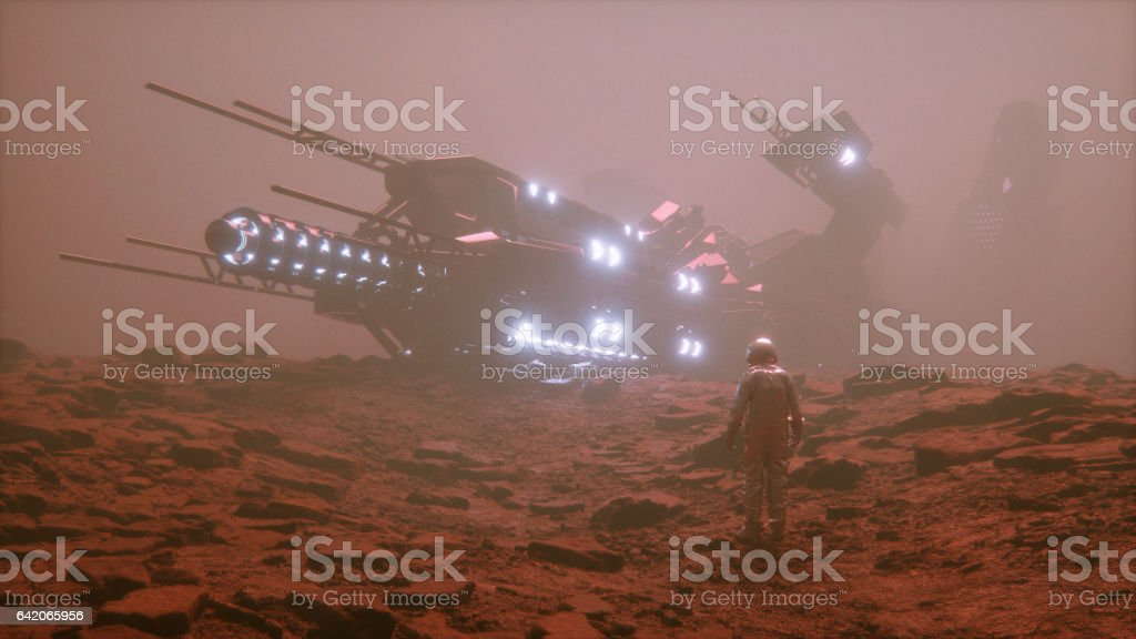 Astronaut discovering alien UFO stock photo