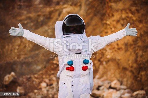 istock Astronaut exploring planet Mars 983212074