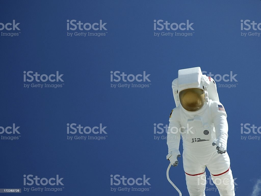 Astronaut Floating Against A Blue Sky stock photo