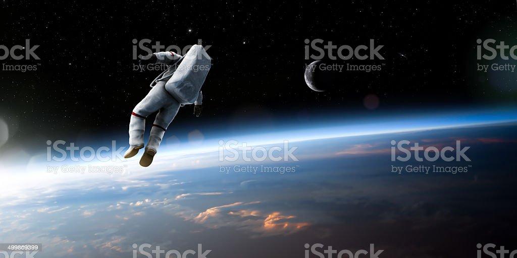 Astronauta galleggiare nell'aria. - Foto stock royalty-free di A mezz'aria