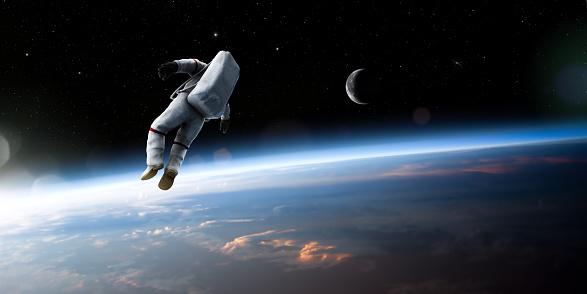 Astronauta Galleggiare Nellaria - Fotografie stock e altre immagini di A mezz'aria