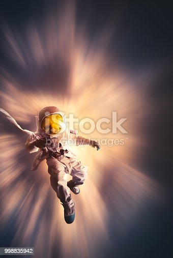 istock Astronaut floating in space 998835942
