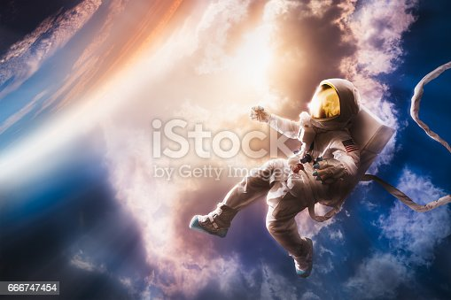 istock Astronaut floating in the atmosphere 666747454