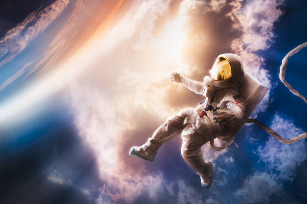 Astronaut floating in the atmosphere stock photo