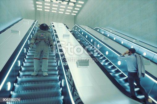 istock Astronaut going down the escalator 906390274
