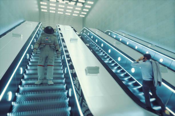 Astronaut going down the escalator stock photo