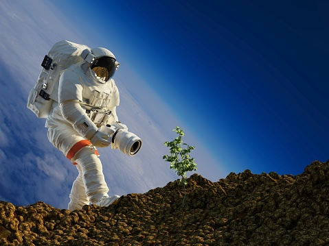 Astronaut planting grass on the planet. 3d render