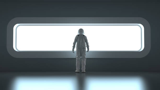astronaut in front of a wide window stock photo