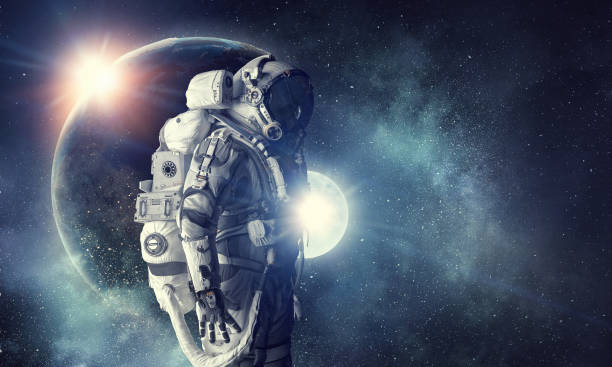 astronaut in outer space. mixed media . mixed media - space and astronomy stock photos and pictures