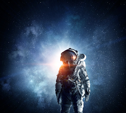 Astronaut in space suit. Elements of this image furnished by NASA
