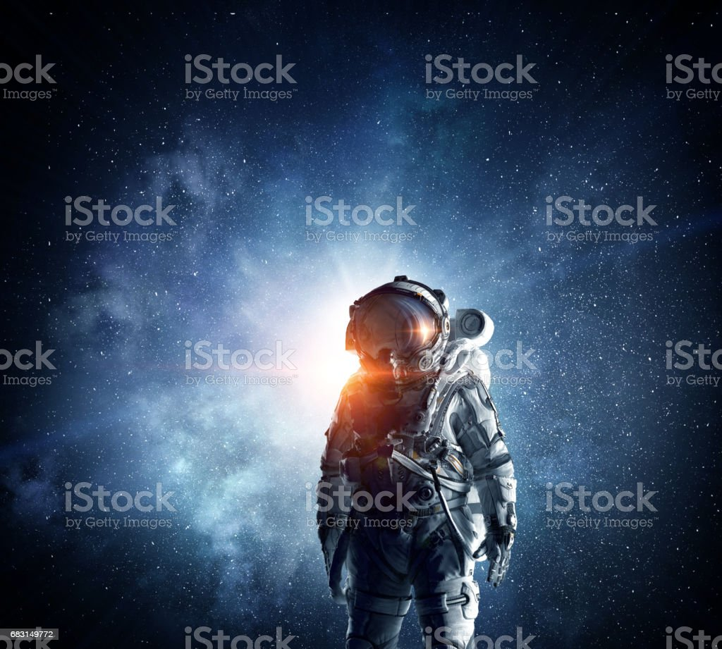 Astronaut in outer space. Mixed media stock photo