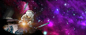 Astronaut in outer space over the planet Earth repairs light. Elements of this image furnished by NASA.\n\n/urls:\nhttps://images.nasa.gov/details-iss036e035133.html\nhttps://images.nasa.gov/details-PIA08655.html\nhttps://images.nasa.gov/details-GSFC_20171208_Archive_e002131.html