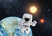 Astronaut in outer space over the planet earth. \n