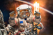 Astronaut in outer space. People in space. Elements of this image furnished by NASA.