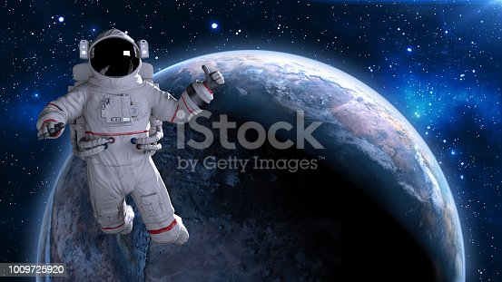 istock Astronaut in space giving thumbs up, cosmonaut floating above planet Earth, 3D render 1009725920