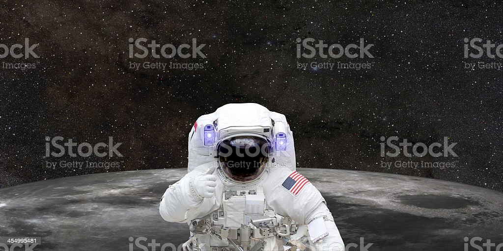 Astronaut in space giving thumbs up stock photo