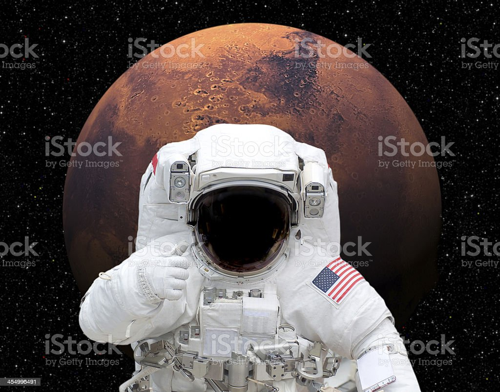 Astronaut in space giving thumbs up to Mars stock photo