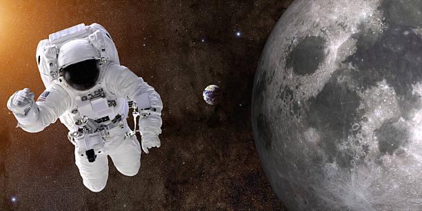 Astronaut In Space Near Moon stock photo