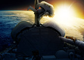 Astronaut in space near space ship with earth planet at background. For this image creation Adobe photoshop was used, as well as 2 NASA images where combined together. Link 1 https://images.nasa.gov/#/details-S84-27023.html Link 2 https://images.nasa.gov/#/details-iss036e005964.html