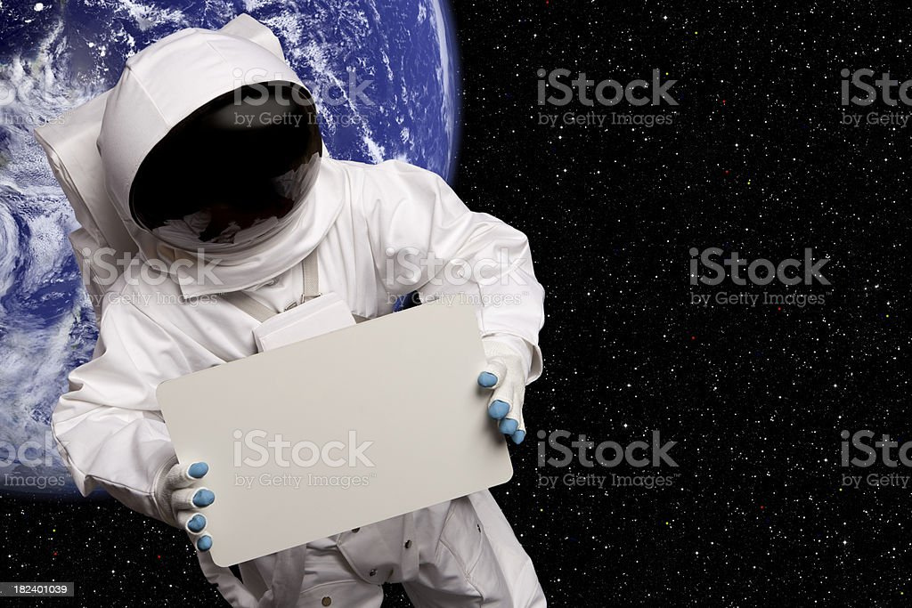 Astronaut In Space Sign Above Blue Planet stock photo