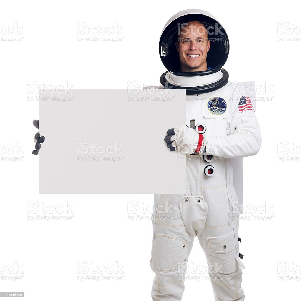 Astronaut Isolated on White Holding a Blank Sign stock photo