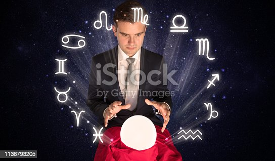 istock Astronaut looking for inspiration in his crystal magic ball 1136793205