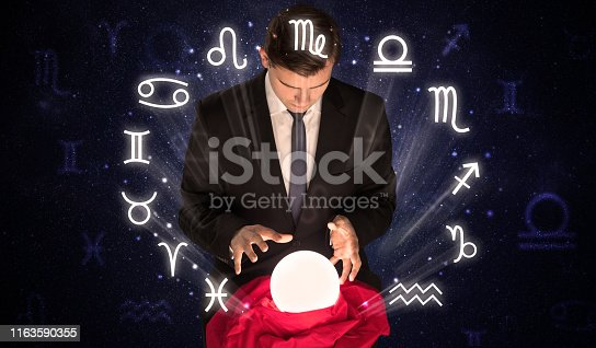 istock Astronaut looking for inspiration in his crystal magic ball 1163590355