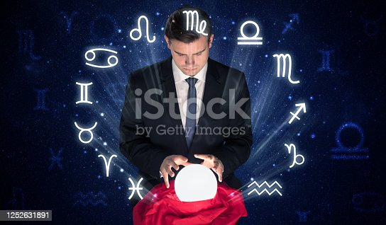 istock Astronaut looking for inspiration in his crystal magic ball 1252631891