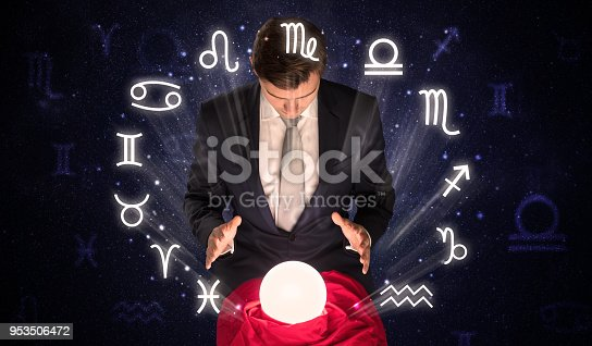 istock Astronaut looking for inspiration in his crystal magic ball 953506472