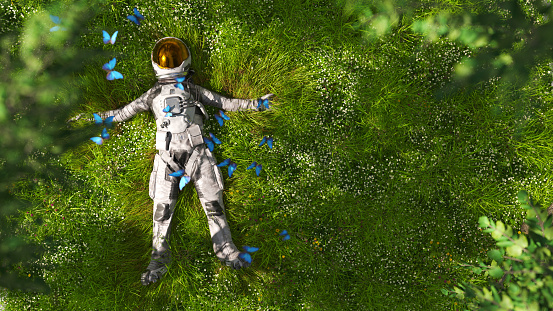 An astronaut in full suit surrounded by monarch butterflies is resting in a lush green garden