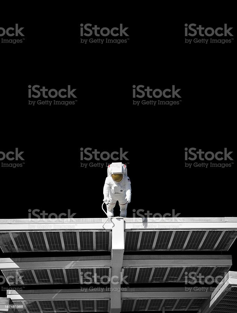 Astronaut on a solar panel floating in space stock photo