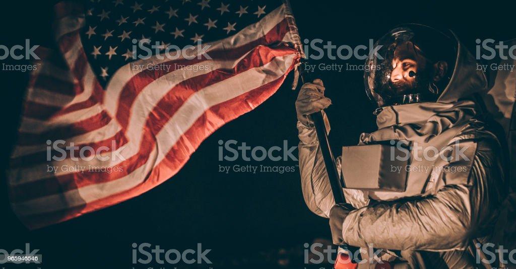 US astronaut on dark planet - Стоковые фото Breaking new ground - английское выражение роялти-фри