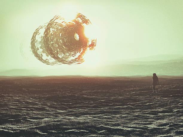 Astronaut on distant planet, UFO, concept stock photo