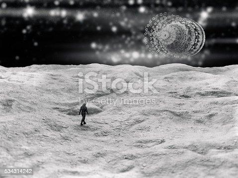 istock Astronaut on distant planet, UFO, concept 534314242