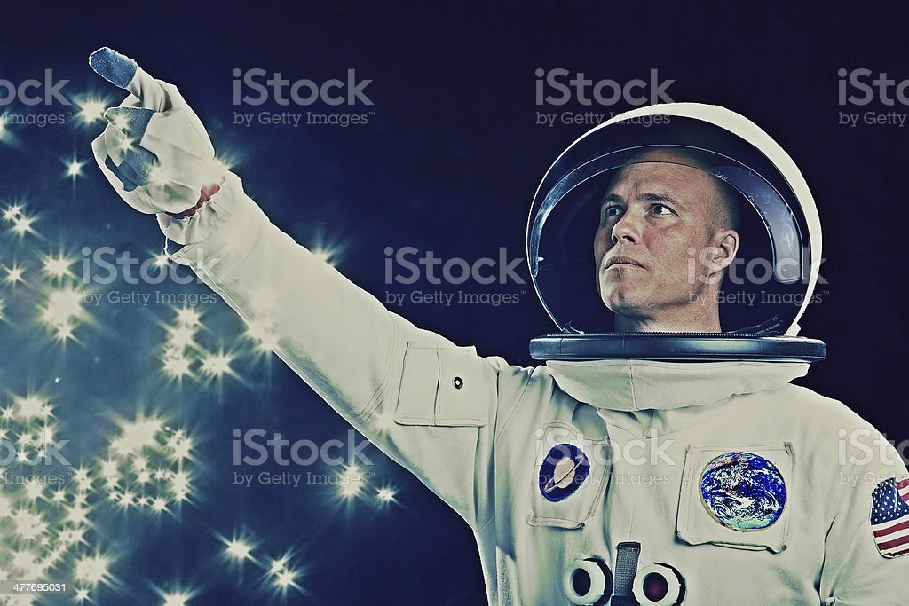 Astronaut Pointing to the Stars stock photo