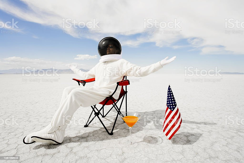 Astronaut Sitting in Lawn Chair stock photo